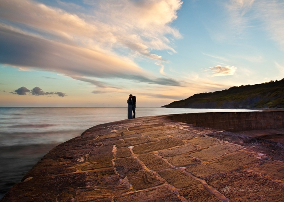 Kissing couple on the Cobb at Lyme Regis